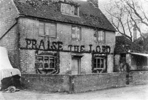 An old grainy picture of the Praise the Lord Cottage